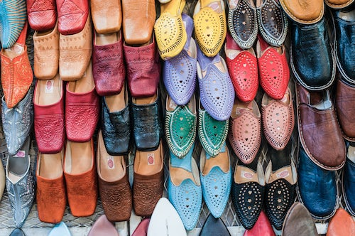 Morocco Travel Photography Colourful babouche mens leather slippers for sale in the Marrakech souks in the old Medina Place Djemaa El Fna Square Morocco North Africa Africa