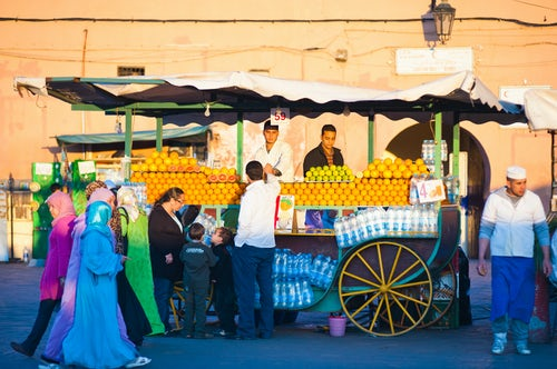 Morocco Travel Photography Fresh orange juice stall Place Djemaa El Fna Square Marrakech Marrakesh Morocco North Africa Africa