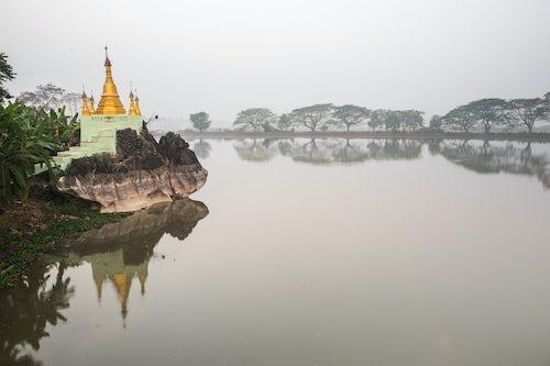 Myanmar Burma Travel Photography Gold stupa at Kyauk Kalap Buddhist Temple at sunrise Hpa An Kayin State Myanmar Burma