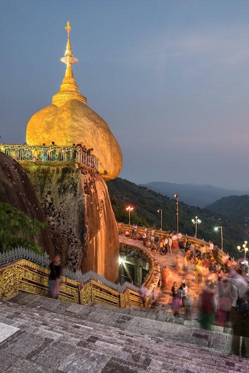 Myanmar Burma Travel Photography Golden Rock at night aka Kyaiktiyo Pagoda a Buddhist Temple in Mon State Myanmar Burma