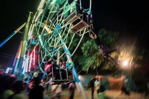 Myanmar Burma Travel Photography Hand operated ferris wheel at Pindaya Cave Festival Shan State Myanmar