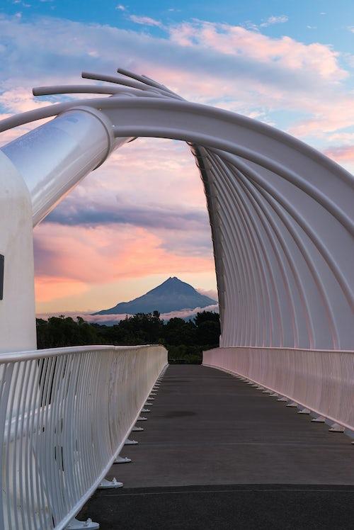 New Zealand Landscape Architecture Photography Te Rewa Rewa Bridge at sunset with Mount Taranaki Mount Egmont behind Taranaki Region North Island New Zealand 2