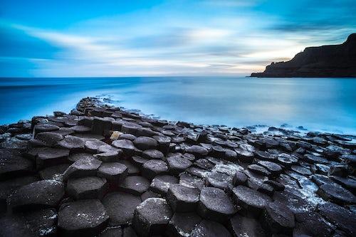 Northern Ireland UK Landscape Photography Giants Causeway and its hexagonal basalt rocks with a dramatic sunrise on the Antrim Coast Northern Ireland 2
