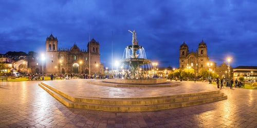 Peru Architecture Travel Photography Plaza de Armas Fountain Cusco Cathedral and Church of the Society of Jesus at night Cusco Peru South America