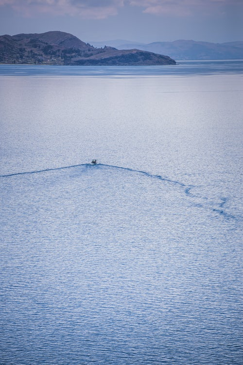 Peru Travel Photography Boat tour on Lake Titicaca seen from Taquile Island Peru South America