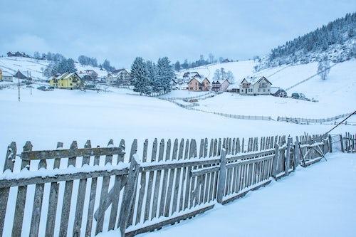 Romania Landscape Travel Photography Village near Bran in the Carpathian Mountains in Winter Transylvania Romania