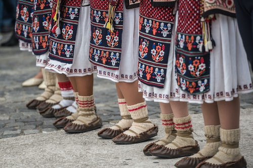 Romania Travel Photography Traditional Romanian clothes and shoes at a celebration in Bucharest Muntenia Region Romania