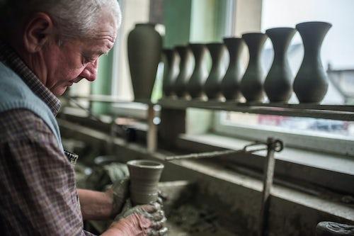 Romania Travel Portrait Photography Documentary Portraiture Man making Marginea Black Pottery Black Ceramics of Marginea Bukovina Romania
