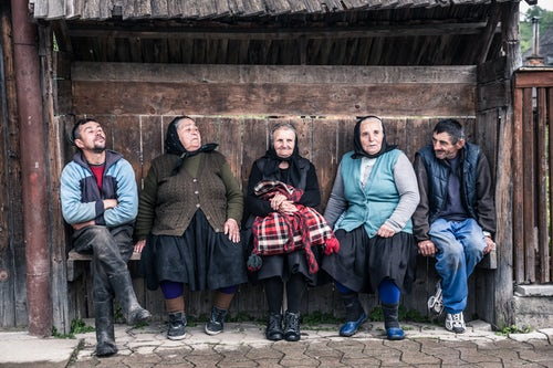 Romania Travel Portrait Photography Documentary Portraiture Portrait of a locals talking in a village in Maramures Romania