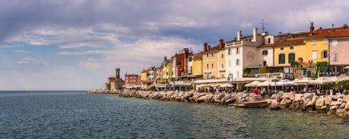 Slovenia Travel Photography Panoramic photo of Piran sea front and Piran Lighthouse Slovenian Istria Slovenia Europe