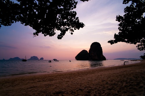 Thailand Beach Travel Photography Beautiful Colourful Purple Tropical Sunset at Ao Phra Nang Beach Railay Rai Leh South Thailand Southeast Asia