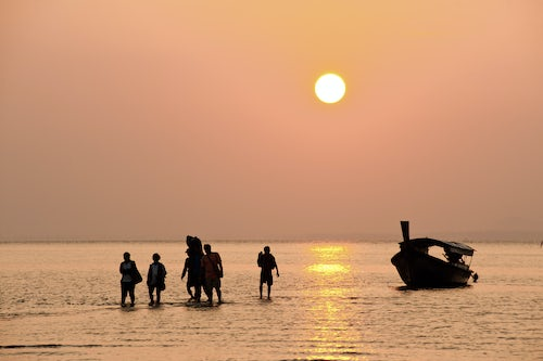 Thailand Travel Photography Silhouetted Tourists Arriving During Sunrise at East Railay Beach a Tropical Paradise in South Thailand Southeast Asia