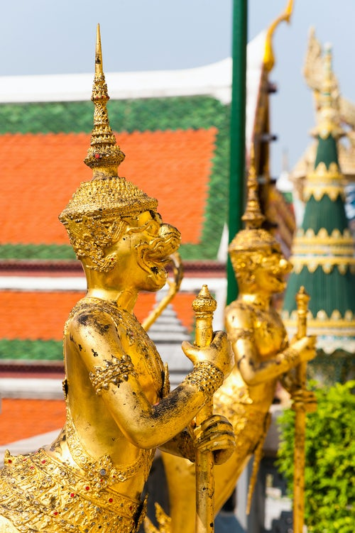 Thailand Travel Photography The Grand Palace two gold guardian statues Bangkok Thailand Southeast Asia Asia Southeast Asia