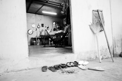 Vietnam Travel Photography Black and White Photo of Shoes Left Outside the Kitchen at a Homestay in the Mekong Delta Vietnam Southeast Asia