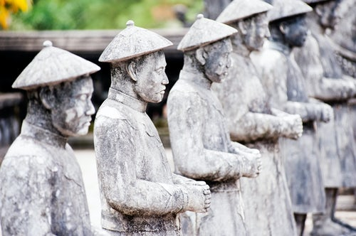 Vietnam Travel Photography Closeup Photo of a Line of Stone Statues at The Tomb of Khai Dinh Hue Vietnam Southeast Asia
