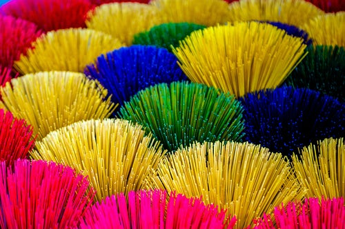 Vietnam Travel Photography Closeup Picture of Colourful Multicoloured Incense Sticks in Hue Vietnam Southeast Asia