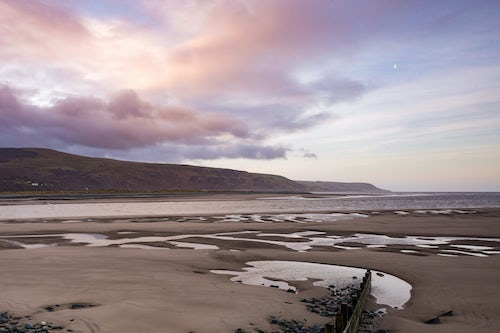 Wales Landscape Photography Wave breaks groins at sunrise Barmouth Harbour Gwynedd North Wales Wales United Kingdom Europe