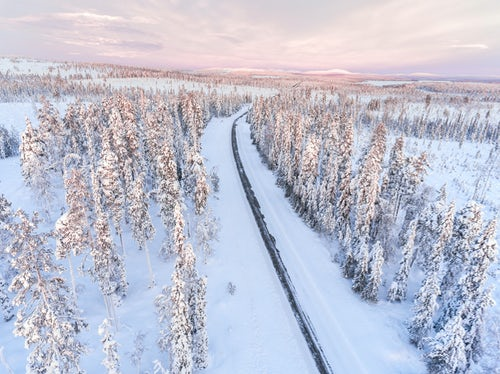Drone Photography by UK London Freelance Drone Photographer Aerial of bad driving conditions on dangerous icy roads in slippery ice and snow covered cold weather winter scenery in Lapland Finland Europe