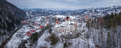 Drone Photography by UK London Freelance Drone Photographer Bran Castle covered in snow in winter Transylvania Romania drone