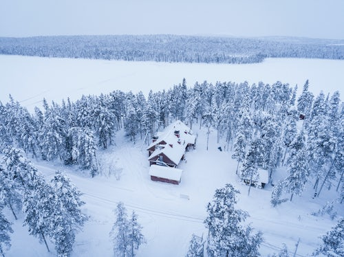 Drone Photography by UK London Freelance Drone Photographer Torassieppi Reindeer Farm Accommodation showing cabins in the woods inside the arctic circle in Finnish Lapland Finland drone