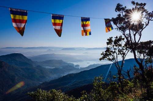 Landscape Photography by Professional Freelance UK Landscape Photographer Adams Peak Sri Pada misty mountain view with Buddhist flags Central Highlands of Sri Lanka Asia