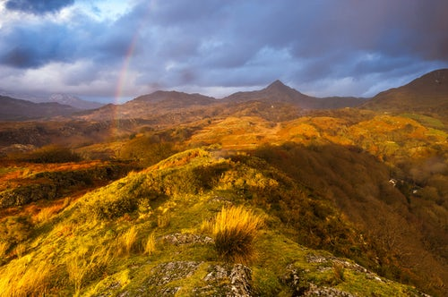 Landscape Photography by Professional Freelance UK Landscape Photographer Cnicht under a rainbow at sunset Snowdonia National Park North Wales