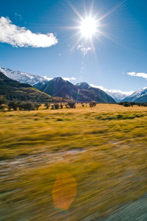 Landscape Photography by Professional Freelance UK Landscape Photographer Driving on a road trip adventure through the Snow Capped Mountains landscape of Aoraki Mount Cook National Park South Island New Zealand