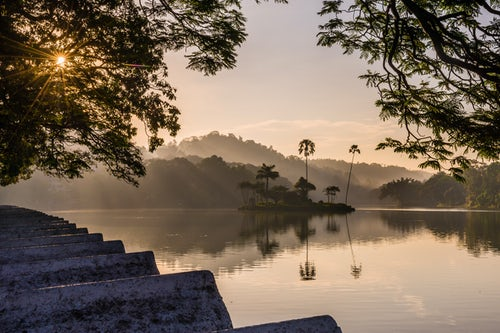 Landscape Photography by Professional Freelance UK Landscape Photographer Kandy Lake and the island which houses the Royal Summer House at sunrise Kandy Central Province Sri Lanka Asia