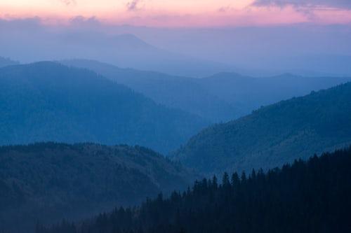 Landscape Photography by Professional Freelance UK Landscape Photographer Misty forest and Carpathian Mountains landscape at sunrise Ranca Parang Mountains Oltenia Region Romania