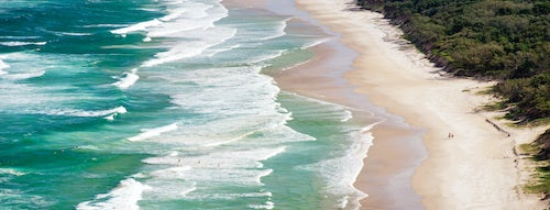 Landscape Photography by Professional Freelance UK Landscape Photographer Panoramic Photo of Surfers Heading Out to Surf on a Deserted Tallow Beach at Byron Bay Gold Coast Australia