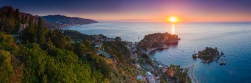 Landscape Photography by Professional Freelance UK Landscape Photographer Panoramic photo of the Sicilian Coast at sunrise showing Isola Bella Beach Taormina Sicily Italy Europe