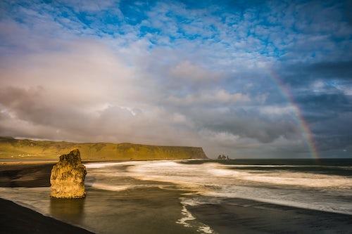 Landscape Photography by Professional Freelance UK Landscape Photographer Reynisdrangar Basalt Sea Stacks and rainbow seen from Dyrholaey Peninsula at sunset near Vik South Iceland Sudurland